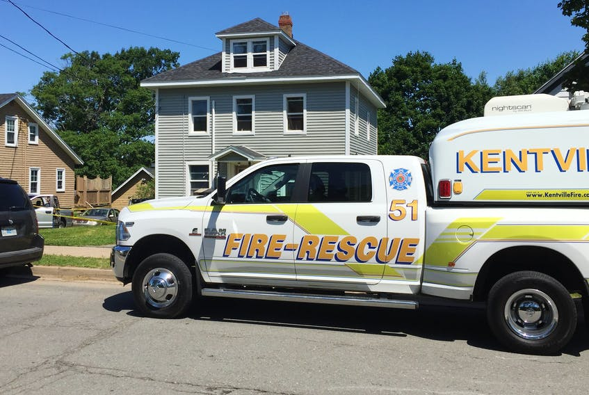 A Kentville Fire vehicle sits at the scene of a fire that displaced six people from their homes in an apartment house on Tuesday evening, July 9, 2019.