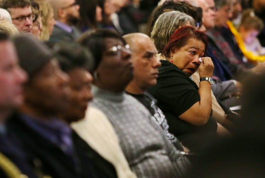 Rose Paris of Halifax wipes a tear during the release of the final report from the Nova Scotia Home for Colored Children inquiry Thursday, Nov. 28, 2019 at the Westin Nova Scotian hotel in Halifax.