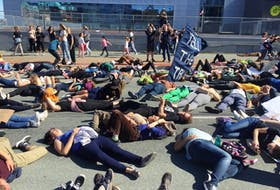 Climate crisis protesters stage a die-in front of Nova Scotia Power headquarters in downtown Halifax on Friday, Sept. 27, 2019.