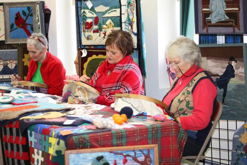 Lynn Denney, left, Mona Pearl and Kay Lewis were rug hooking as part of an Art and Rug Hooking Show and Sale, part of Imagine Kentville Christmas activities Dec. 7.
