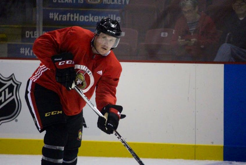 Dion Phaneuf looks to pass during the Ottawa Senators pre-game skate at Credit Union Place.