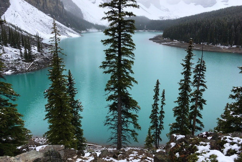 The brilliant colour of Moraine Lake, near Lake Louise, is enhanced by a pre-summer snowfall. Alberta's more picturesque locations were featured in a government video promoting Edmonton's bid to become an NHL hub city.