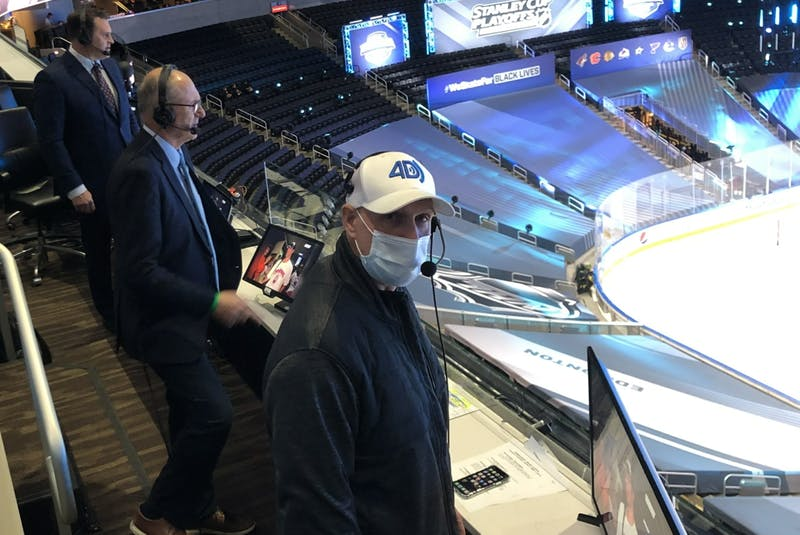 With no fans at Rogers Place, Sportsnet colour commentator Louie DeBrusk, left, play-by-play voice Chris Cuthbert and in-game stats man David Moir call an NHL playoff game from their makeshift booth in the seating area instead of higher up in the press box. - Photo  supplied