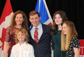 An election day family portrait of Premier Andrew Furey and his Allison and children Mark, 9, Maggie, 14 and Rachel, 12, following his election victory speech. -Joe Gibbons/The Telegram