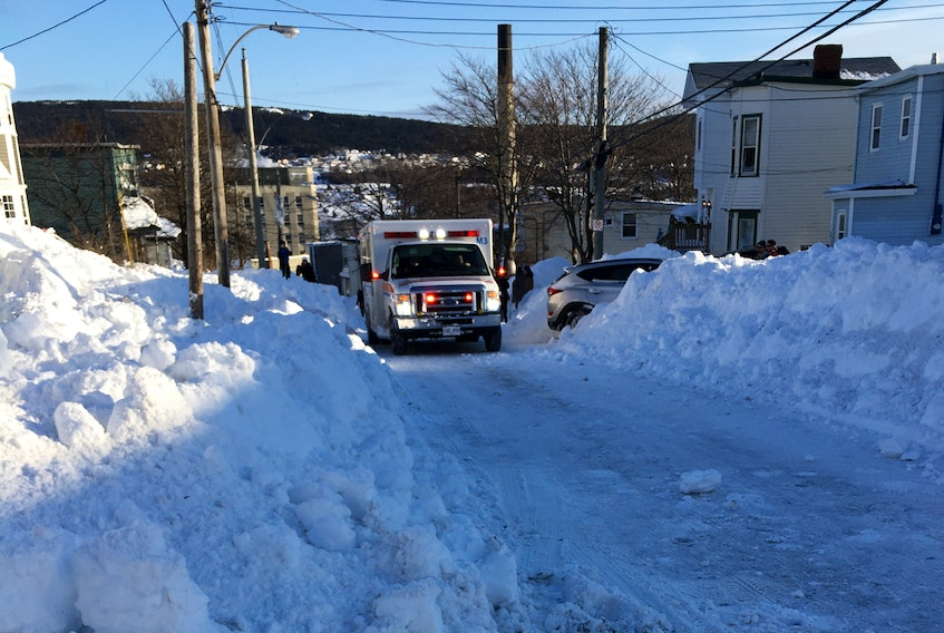 An ambulance with flashing lights in centre city St. John's Sunday, which had to wait for a vehicle to move out of its way. Eastern Health says it's imperative for non essential traffic to obey the state of emergency rules.