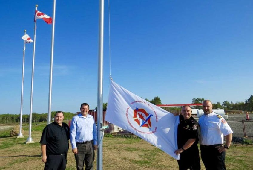 Pictured here at the Canadian Volunteer Fire Services Association flag raising ceremony are, from left, Cpt. Bill Hazel (Hantsport Fire Department) Burnell Lyons (store manager of Sweetgrass Convenience) Deputy Fire Chief Paul Maynard (Hantsport Fire Department and a CVFSA director) and Chief Todd Crowell (Wolfville Fire Department).