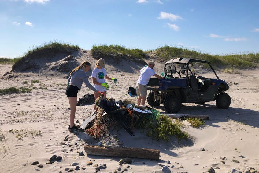 The Indian Bay Ecosystem Corporation is working to clean the Cape Freels beach area and track the shorebirds that nest there as a part of its work to be environmentally sound in Bonavista North. Shown here (from left) are Candace Parsons, Danielle Rogers and manager Darren Sheppard in Cape Freels recently. — Photo courtesy Darren Sheppard