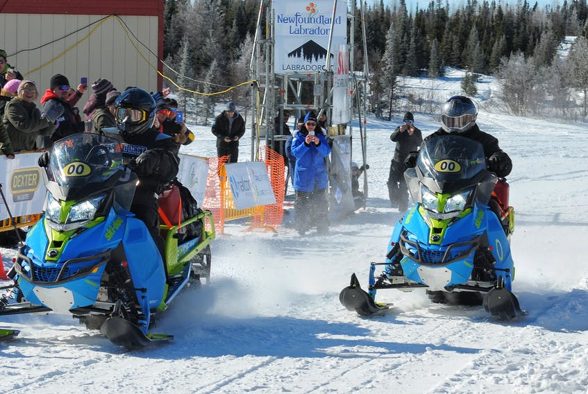 Aaron Poker and Len Rich crossing the finish line in 2018. FILE/THE LABRADOR VOICE