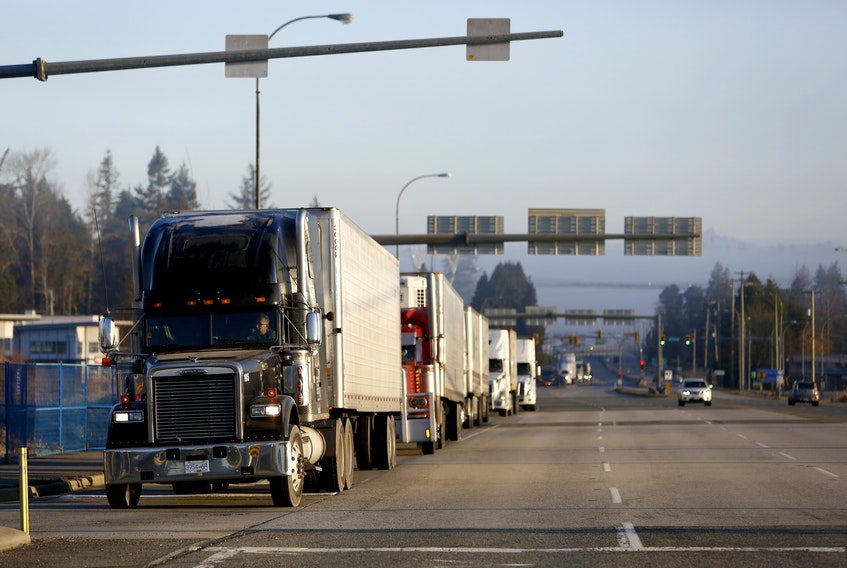 Trucks line up to U.S. customs to enter into Blaine, Wash., at the truck route border crossing.   REUTERS/Jesse Winter
