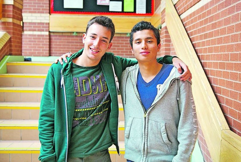 <p>Egemen Sahan and José Chona Peña became friends through the international program at Liverpool Regional High School.</p>