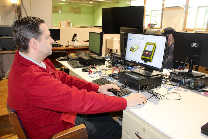 Matt Swann, director of the Nova Scotia Power MakerSpace, demonstrates the SoldWorks design software found in the MakerSpace on Nepean Street, Sydney. Designs are created with the software and then the files transferred to other equipment on site. GREG MCNEIL/CAPE BRETON POST