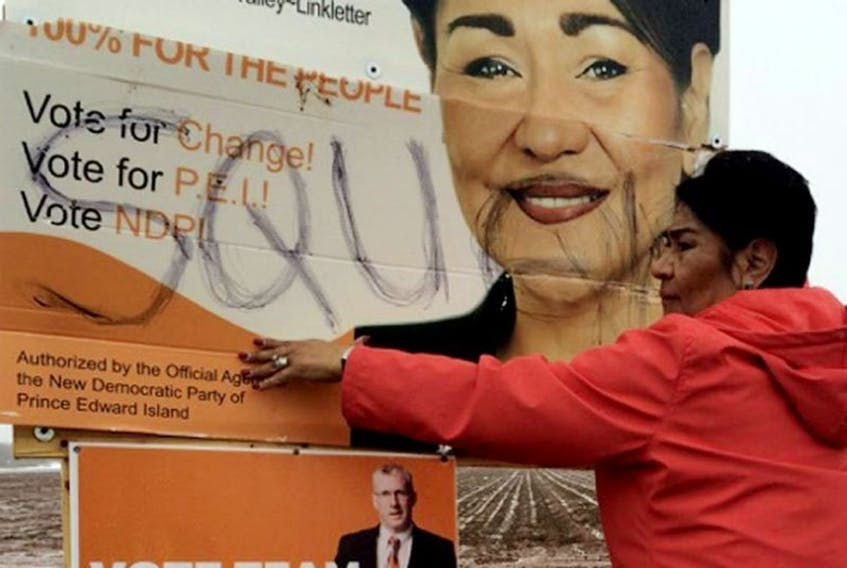 A sign for NDP candidate Jacqueline Tuplin bears a racist term someone wrote on it.