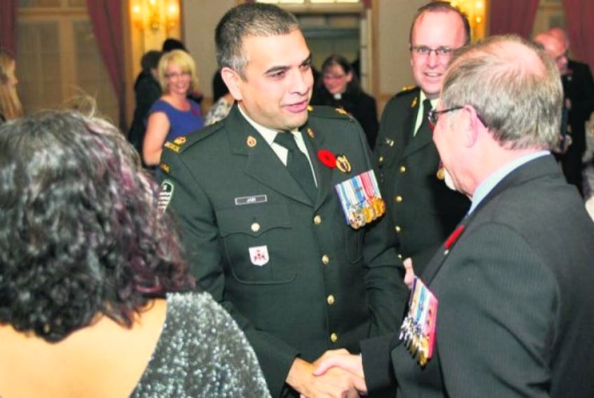 <p><span>Major Trevor Jain, left, and Chief Warrant Officer Michel Guay, right, congratulate each other after being honoured during the Mayor's 11</span>th<span>Annual Veterans Recognition Awards at the Charlottetown Hotel Nov. 8 . Lt.–Col. Steven Wynne, centre, was also honoured during the ceremony.</span></p>