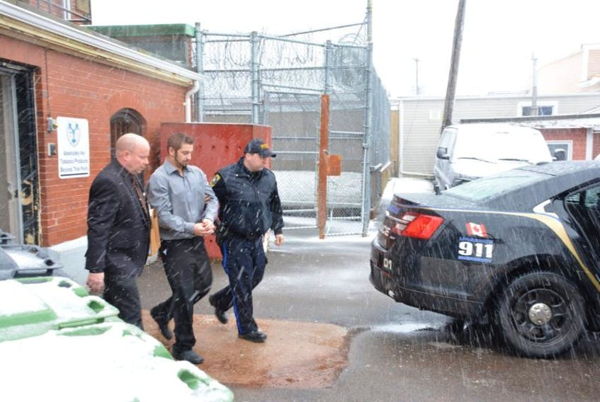 James Russell Purdy, 29, being led away from the Summerside courthouse on Friday. Purdy was sentenced to seven years in custody for breaking into a Summerside man's home and beating him nearly to death. Colin MacLean/Journal Pioneer