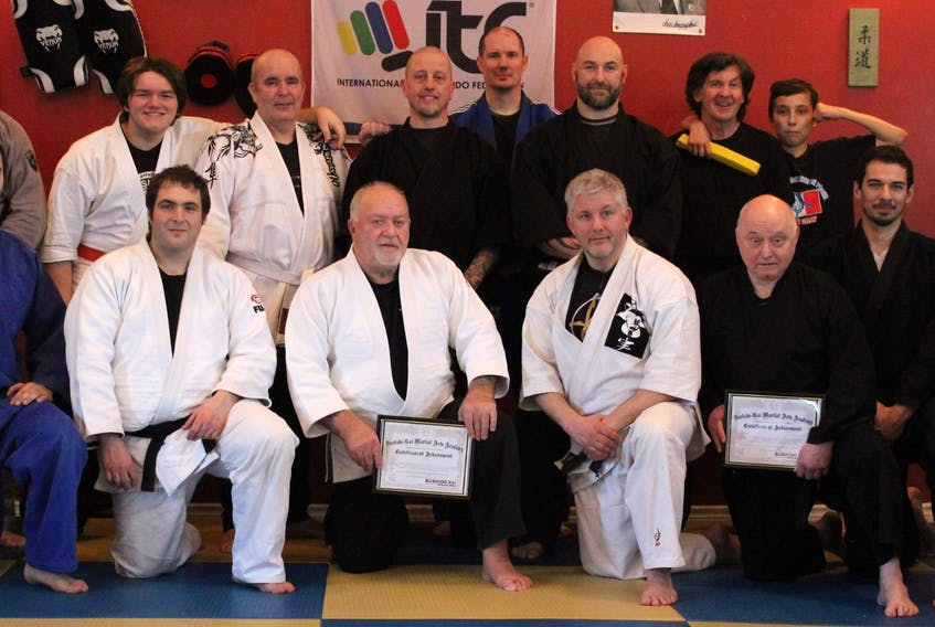Last month, Ray MacKinnon from Bushido Kai visited Integrity Martial Arts in Sydney to conduct a seminar and Japenese jujitsu grading. Terry MacFarlane received a fourth-degree, while Donald Orychuck was given a second-degree, both in Japenese jujitsu. From left, front row, Ben Pincock, Andrew Hawco, Donald Orychock, Ray MacKinnon, Terry MacFarlane, Jeremy Ford and Ryan Caines; back row, Troy McCarthy, Matt MacDonald, Chris King, Derek Sampson, Trevor Whitewood, Jimmy Hall, Kevin MacDonald and Luca Diflavio. CONTRIBUTED/JIMMY HALL