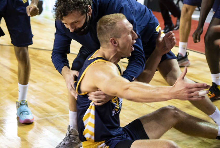 Jordan Baker is congratulated by his Edmonton Stingers teammates after scoring the winning basket of an 87-86 victory over the Niagara River Lions on Friday, July 31, to record the Canadian Elite Basketball League's first-ever come-from-behind win in an Elam Ending finish. (Supplied/CEBL)