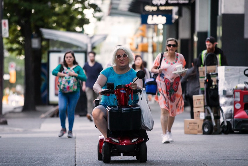 Jessica Yaniv, centre, arrives for a B.C. Human Rights Tribunal hearing in Vancouver, on Friday July 26, 2019.