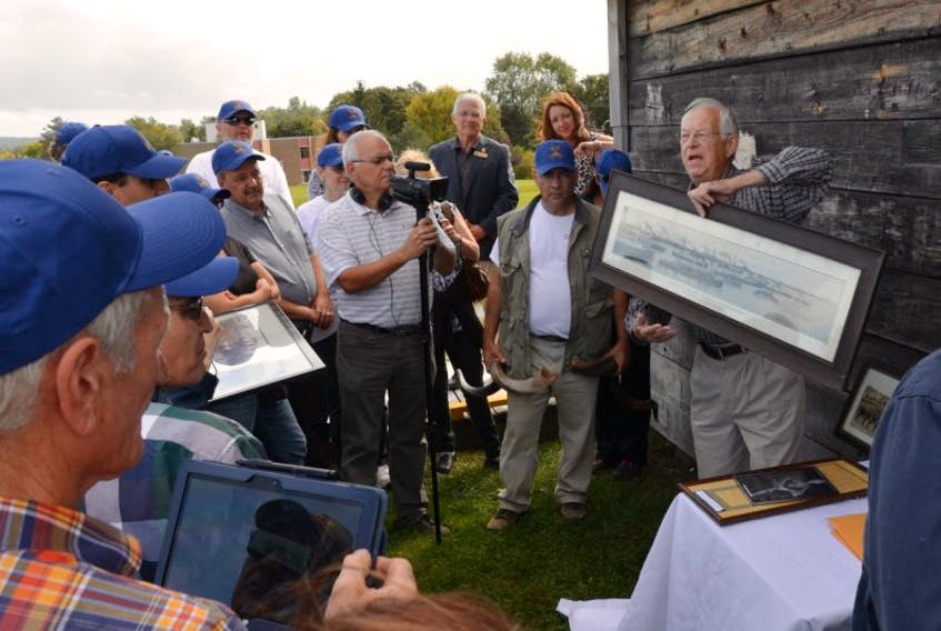 <p>John Wilson displays some of the artifacts highlighting the Jewish Legion, which was stationed in Windsor during the First World War. One of the soldiers in the legion was David Ben-Gurion, who would go on to become the first Prime Minister of Israel.</p>