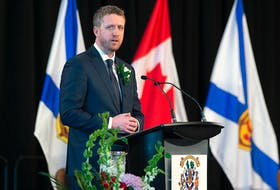 Nova Scotia Premier Iain Rankin addresses the audience after taking his oath of office in Halifax on Feb. 23. - Pool
