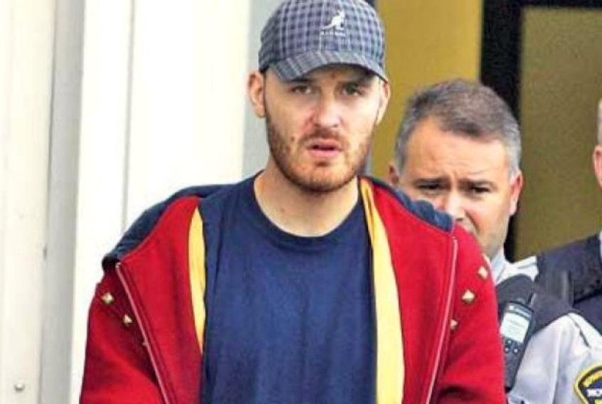 Jimmy Melvin Jr. is escorted out of Dartmouth provincial court in this file photo.