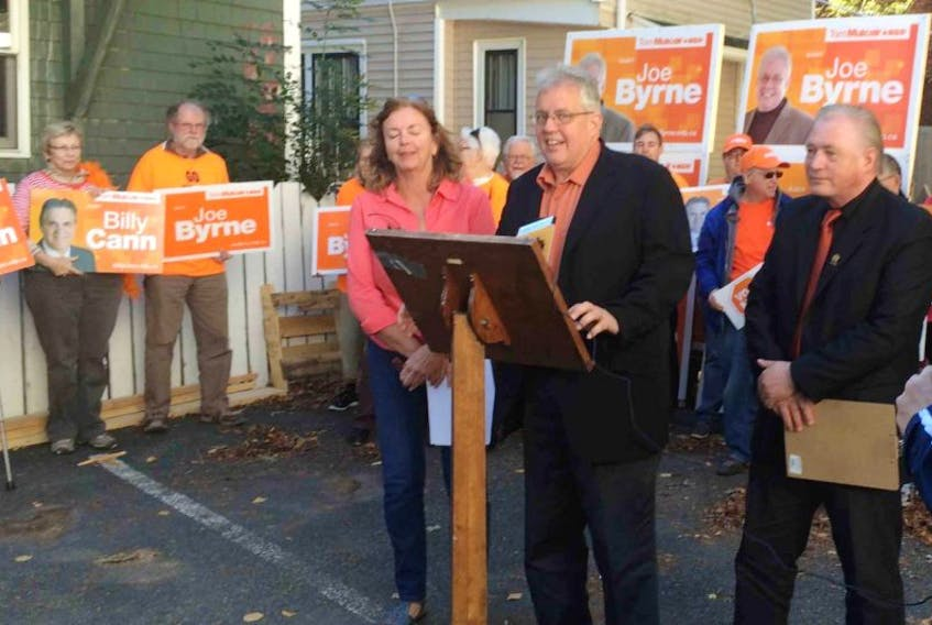 Charlottetown NDP candidate Joe Byrne, at the podium, held a press conference today to unveil the party's platform in Atlantic Canada.