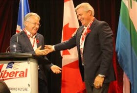 Liberal Party president John Allan and Premier Dwight Ball stand onstage together at Liberal Party convention in Gander Sept, 30, 2017. Allan called on Liberals to show unity and stand behind Ball.