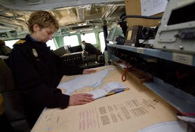 Commander Josée Kurtz looks over navigational charts on the bridge of the HMCS Halifax prior to an interview at HMC dockyards in Halifax Tuesday April 7, 2009 Commander Kurtz, assumed the command of the frigate HMCS Halifax on April 6, 2009 and is the first woman in the Canadian military to command a warship.