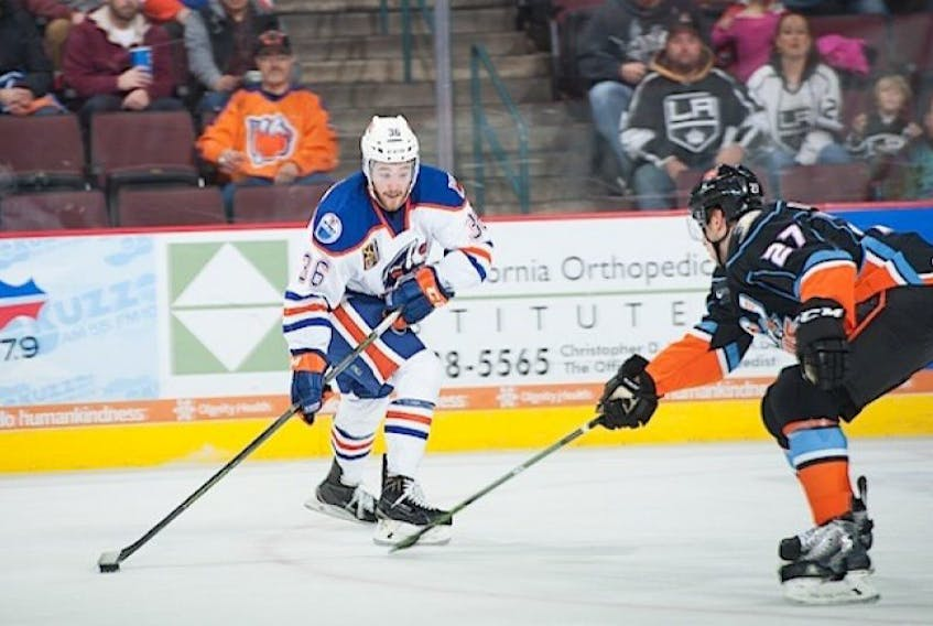 """<p><span class=""""Normal"""">Josh Currie, left, is playing in the American Hockey League with the Bakersfield Condors.</span></p>"""