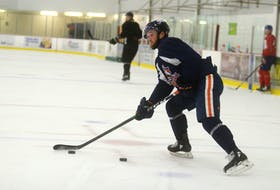 Charlottetown native Josh Currie skates with other Island professional hockey players at MacLauchlan Arena in June.