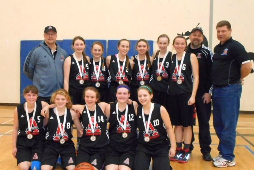 The Junior Axewomen midget D-1 girls' basketball team captured the Metro midget/juvenile championship March 1. Team members include, in front, from left, Sara Cumby, McKinley Bezanson, Hannah Fuller, Talia Boutilier and Calla Newcomb. In back are coach Fred Cumby, Abbie Fox, Emily Zwicker, Lauren Thomson, Claire Belliveau, Jami Horne, Meghan MacLeod, coaches Jay Fuller and Charlie Newcomb.