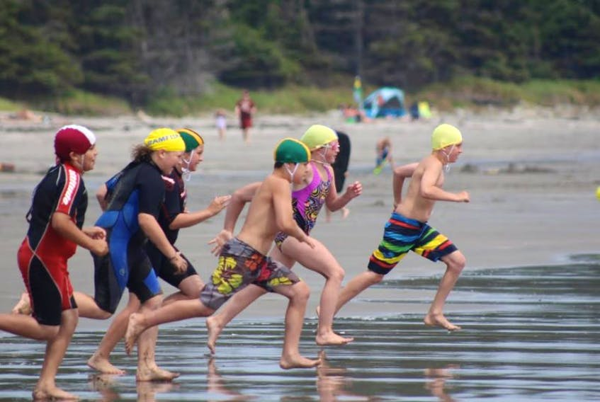 Junior Lifeguards competing at the Junior Lifeguard Championships at Rissers beach on July 26.