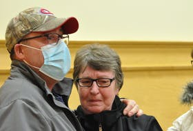 Sheldon Pollard hugs his mother, Joy Pollard, after a jury convicted Thomas Whittle of causing the death of his nephew and her grandson, Justyn Pollard, in Newfoundland and Labrador Supreme Court in Corner Brook on Monday night.