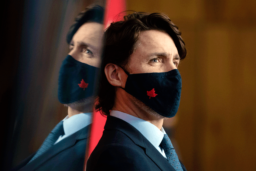 Prime Minister Justin Trudeau participates in a news conference on the COVID-19 pandemic in Ottawa, Friday, March 12, 2021.