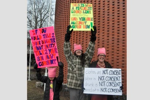 Carrying colourful signs, protestors stood outside the Kentville provincial courthouse March 9 to send a message to Judge Gregory Lenehan after a controversial ruling in a sexual assault case involving a Halifax cab driver.