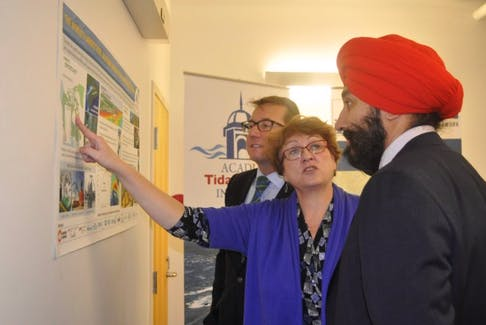 Navdeep Bains, federal minister responsible for the Atlantic Canada Opportunities Agency, right, and Kings Hants MP Scott Brison, left, toured Acadia's Tidal Institute while in Wolfville Jan. 27.