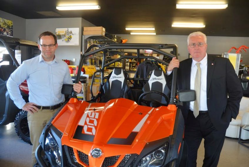 Go Power Sports owner Greg Foran is concerned how proposed tax law changes will affect his enterprise and other small and medium businesses. Deputy Opposition Whip John Brassard, Conservative MP for Barrie-Innsisfi, Ontario, visited on Oct. 5 to discuss those concerns.