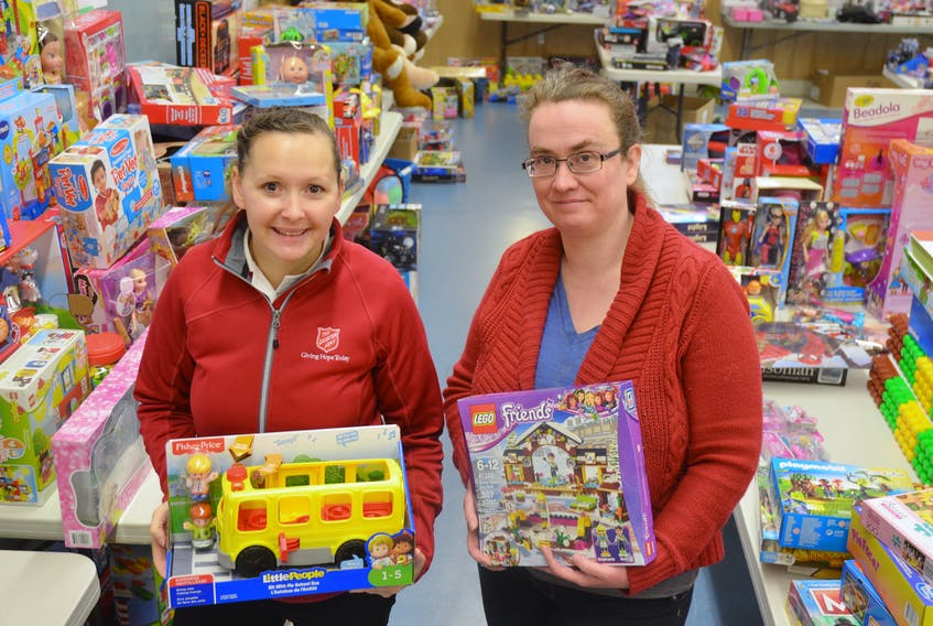 """Capt. Kelly Fifield of the Kentville Salvation Army and volunteer Beverly Burton were among those helping to set up a toy store at the community church on Dec. 19. The organization is in """"urgent"""" need of donated toys."""