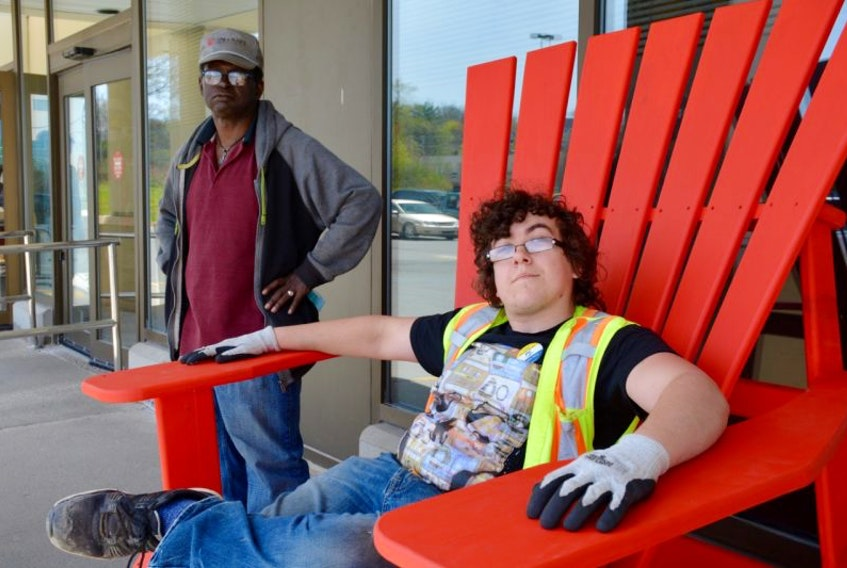 Edmond Sparks, left, and David Weir helped build the oversized Adirondack chair for Sobeys' Windsor location.