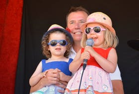 Scott Brison's twin girls Rose and Claire, 3-years-old, stole the show, singing O Canada and having fun with the audience.