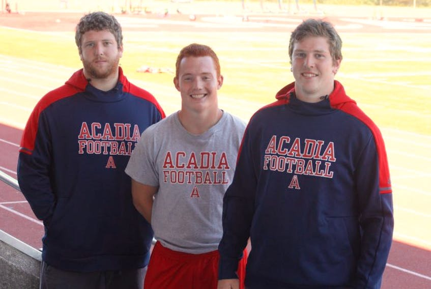 Horton High graduates (left to right) Adam Melanson, Cameron Davidson and Isaac Melanson, as well as their former Horton teammate Brandon Whitman (not pictured), are all part of the Acadia football Axemen roster for the 2017 season.