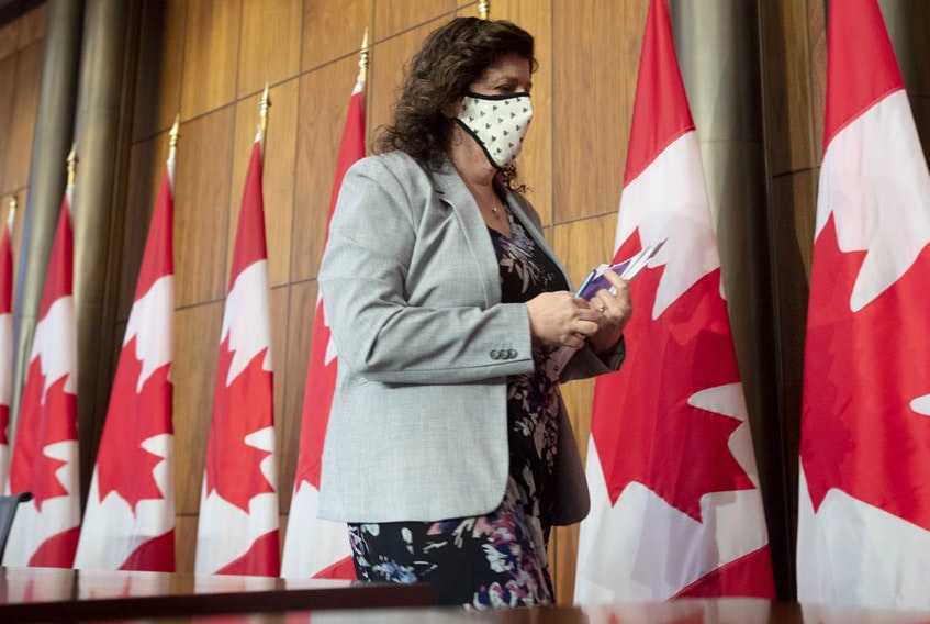 Auditor General Karen Hogan leaves a news conference in Ottawa, Thursday March 25, 2021.