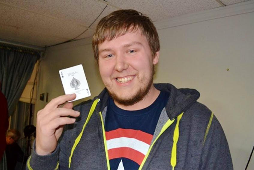 Tignish Chase the Ace grand prize winner Keaton Noye with the winning card he drew Friday, Nov. 27, 2015.