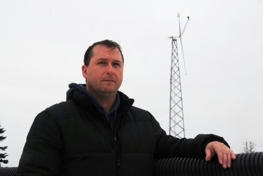 <p>Robert Wood, manager of the Community Gardens Complex in Kensington, with the rink's windmill. The turbine, one of four built at Island rinks under the same program, is being torn down because of ongoing performance problems. Journal Pioneer file photo</p>