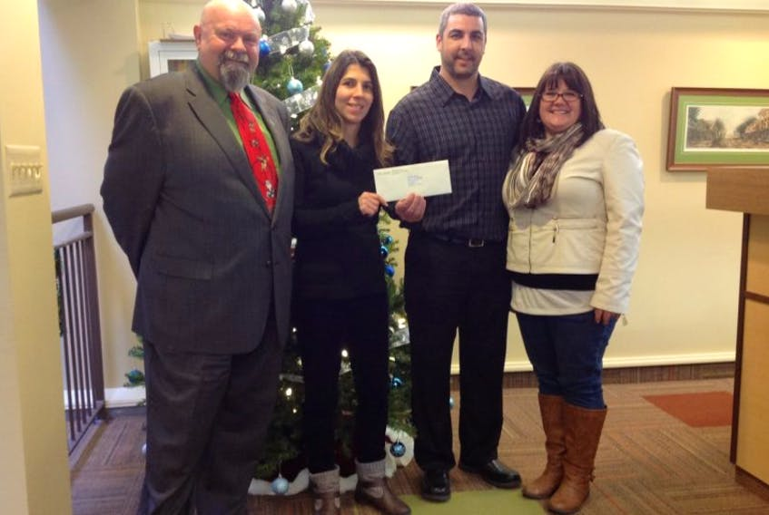 <p>Kentville Mayor Dave Corkum and after school program leader Dana Feltham accept a $12,000 cheque from Weston Bakeries Amherst plant manager Tyler McLeod and Tina McLeod. - Submitted</p>