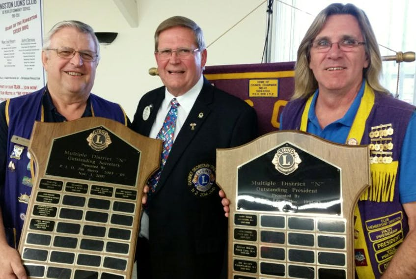 The Kingston Lions Club was recently recognized by the Lions Multiple District N for having the 2013–2014 outstanding president and outstanding secretary. Lions Multiple District N (MD N) is composed of 237 Lions Clubs, totalling 5,611 members across Nova Scotia, New Brunswick, Newfoundland & Labrador and three Lions Clubs in the northern part of Maine. These prestigious awards recognize the success, leadership and efforts put forth by past King Lion Richard Acker and past secretary Vern Mullen during their tenure. This is the first time that a club has received both these awards in the same year and the second year in a row Kingston has received the outstanding president recognition. Pictured are Mullen, left, and Acker, right, being presented their awards by council secretary treasurer Bob Lyle, also of the Kington Lions Club, on behal of the MD N Council and chairman Scott MacKenzie.