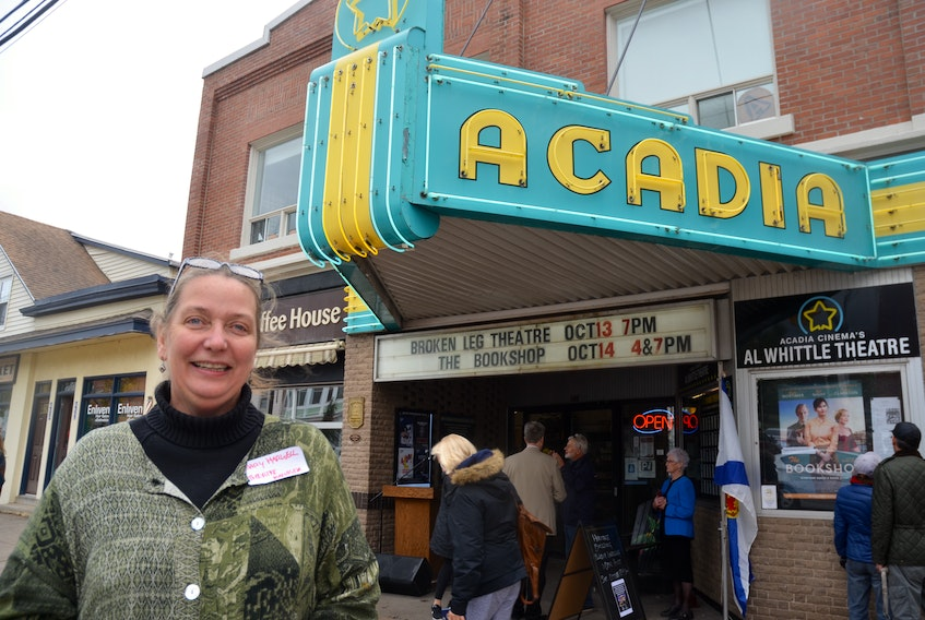 Al Whittle Theatre manager Mary Harwell had the honour of unveiling plaques officially designating the Acadia Cinema building a municipal and provincial heritage property. - Kirk Starratt