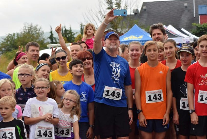 Fred Fox, Terry Fox's older brother, takes a selfie with the crowd at the Terry's Warm Up event hosted in Port Williams Sept. 16.