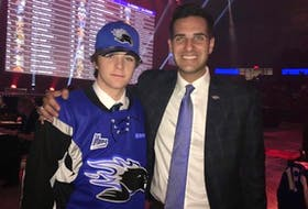 Brady Burns, left, was selected in the second round of the QMJHL draft recently. He is pictured alongside Trevor Georgie, president and general manager of the Saint John Sea Dogs