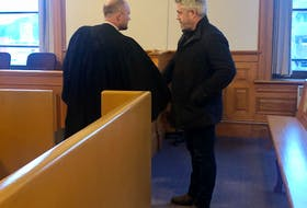 Kurt Churchill (right) shakes the hand of his lawyer, Robby Ash, before leaving Newfoundland and Labrador Supreme Court in St. John's Monday afternoon.