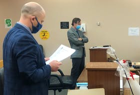 Kurt Churchill's lawyer, Robby Ash (foreground), and prosecutor Mike Murray proceeded with Churchill's trial Monday, even though Churchill was not present in the courtroom. The 43-year-old was convicted of threatening a police officer in March 2019.
